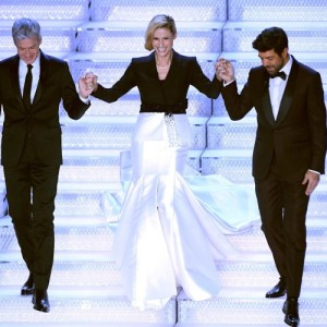 Sanremo Festival artistic director Claudio Baglioni (L), Swiss-Italian TV showgirl Michelle Hunziker (C) and Italian singer and Italian actor Pierfrancesco Favino (R) on stage during the 68th Sanremo Italian Song Festival at the Ariston theatre in Sanremo, Italy, 08 February 2018. The 68th edition of the television song contest runs from 06 to 10 February. ANSA/CLAUDIO ONORATI